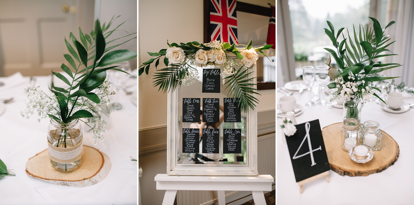 close up of fern table centre pieces and mirror table plan