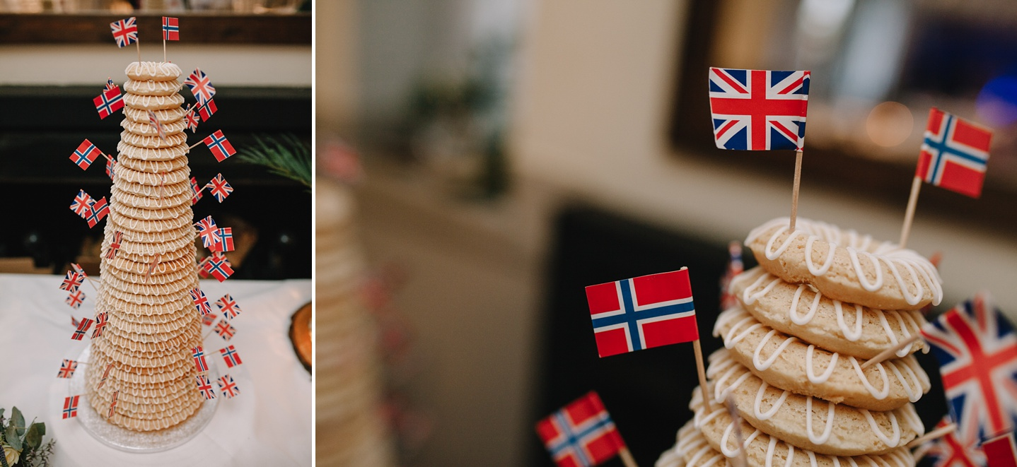 close up if traditional danish kransekake cake with little United Kingdom and Danish flags on