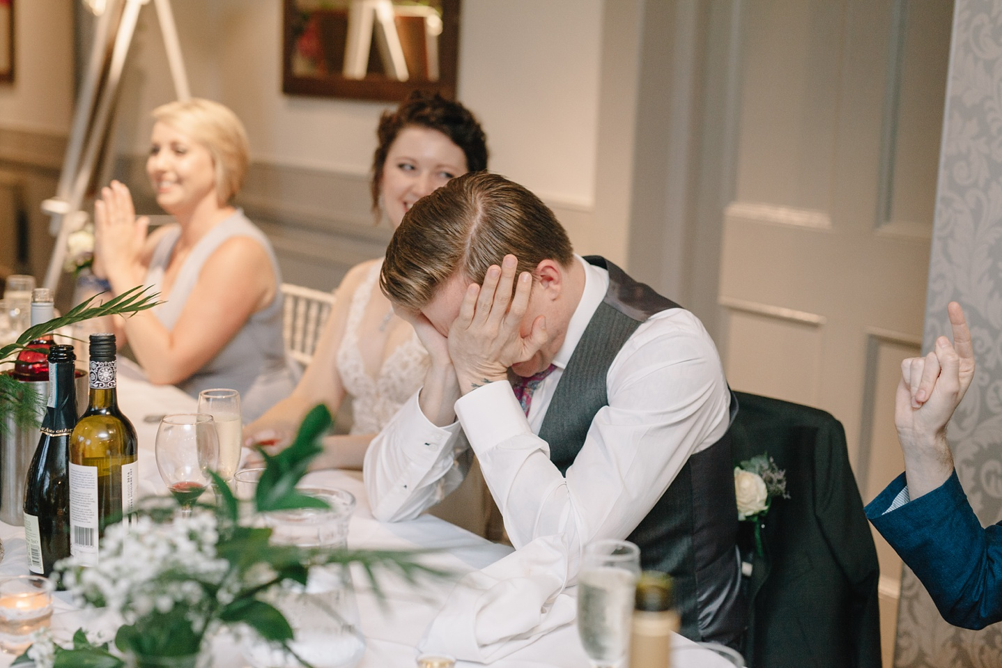 groom with head in hands embarrassed during speeches at Whirlowbrook Hall wedidng