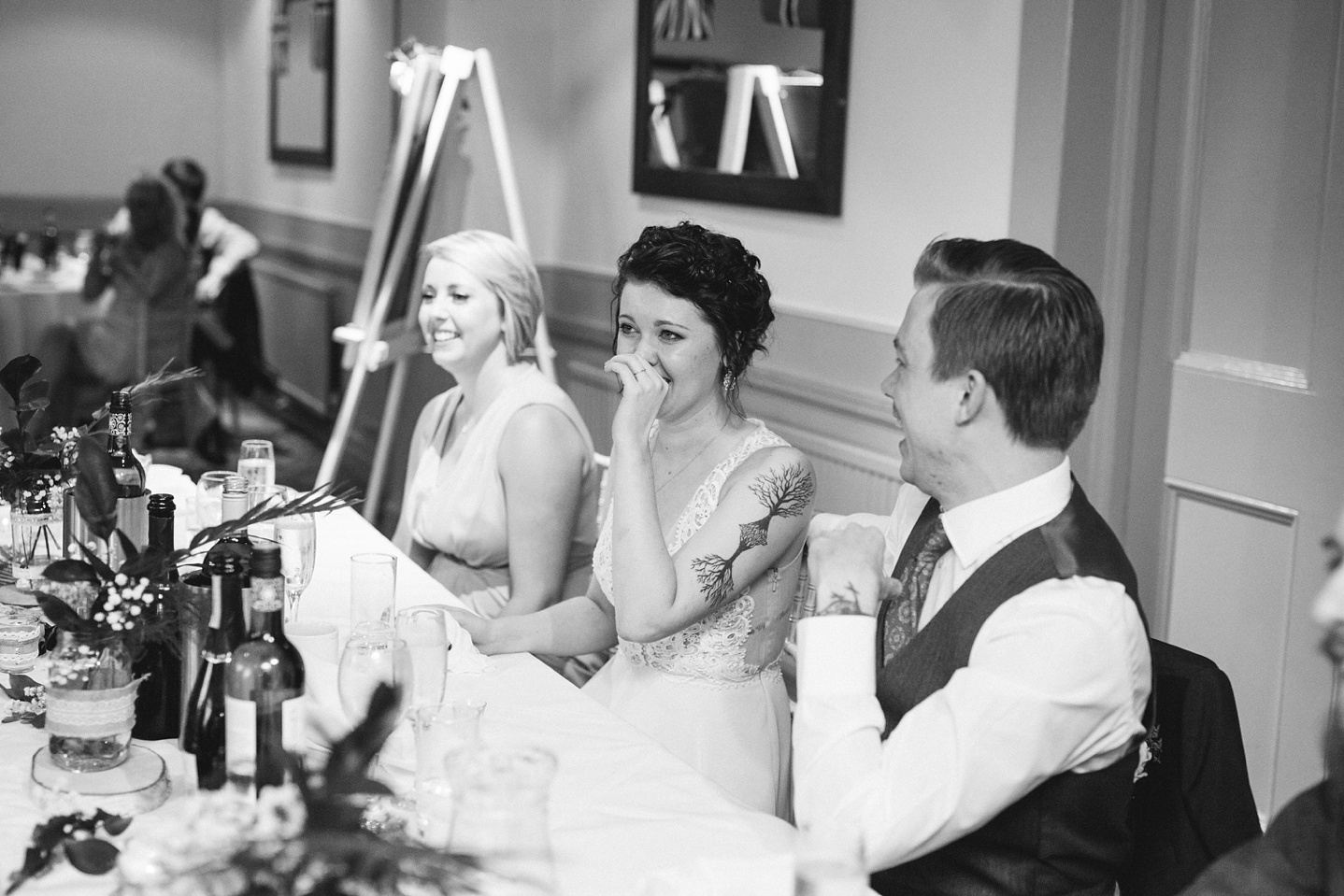 black and white photo of bride laughing at speeches at Whirlowbrook hall wedding