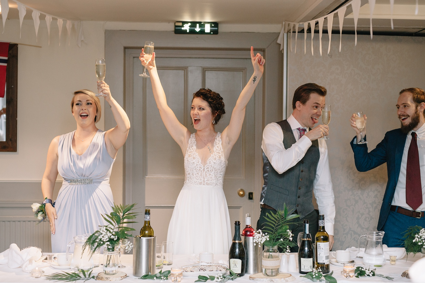"""bride and groom celebrating with a """"yay"""" toast during speeches"""