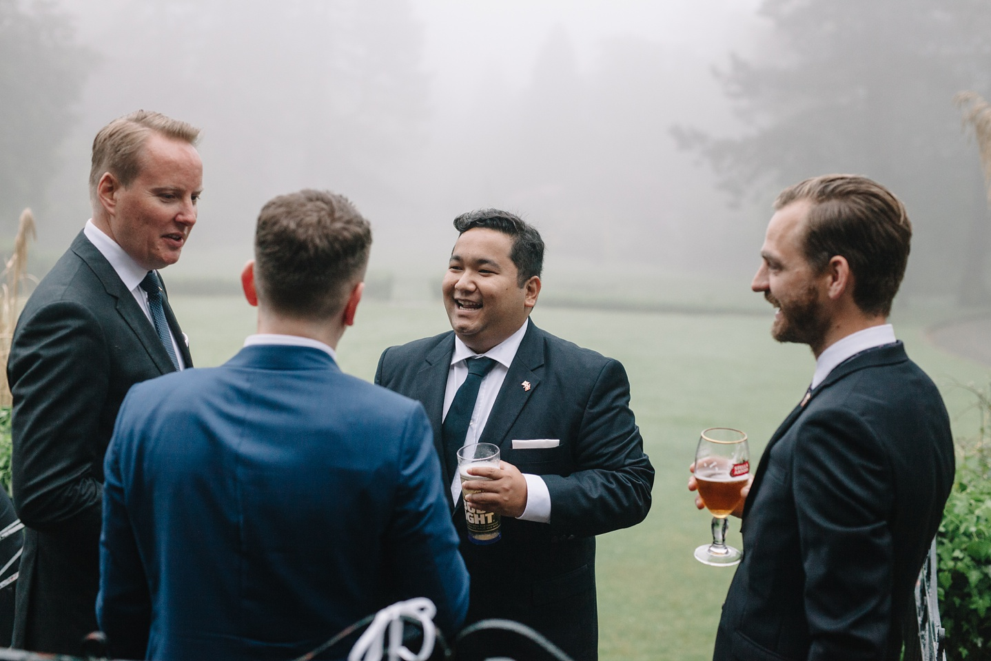 guests laughing in the gardens of Whirlowbrook Hall