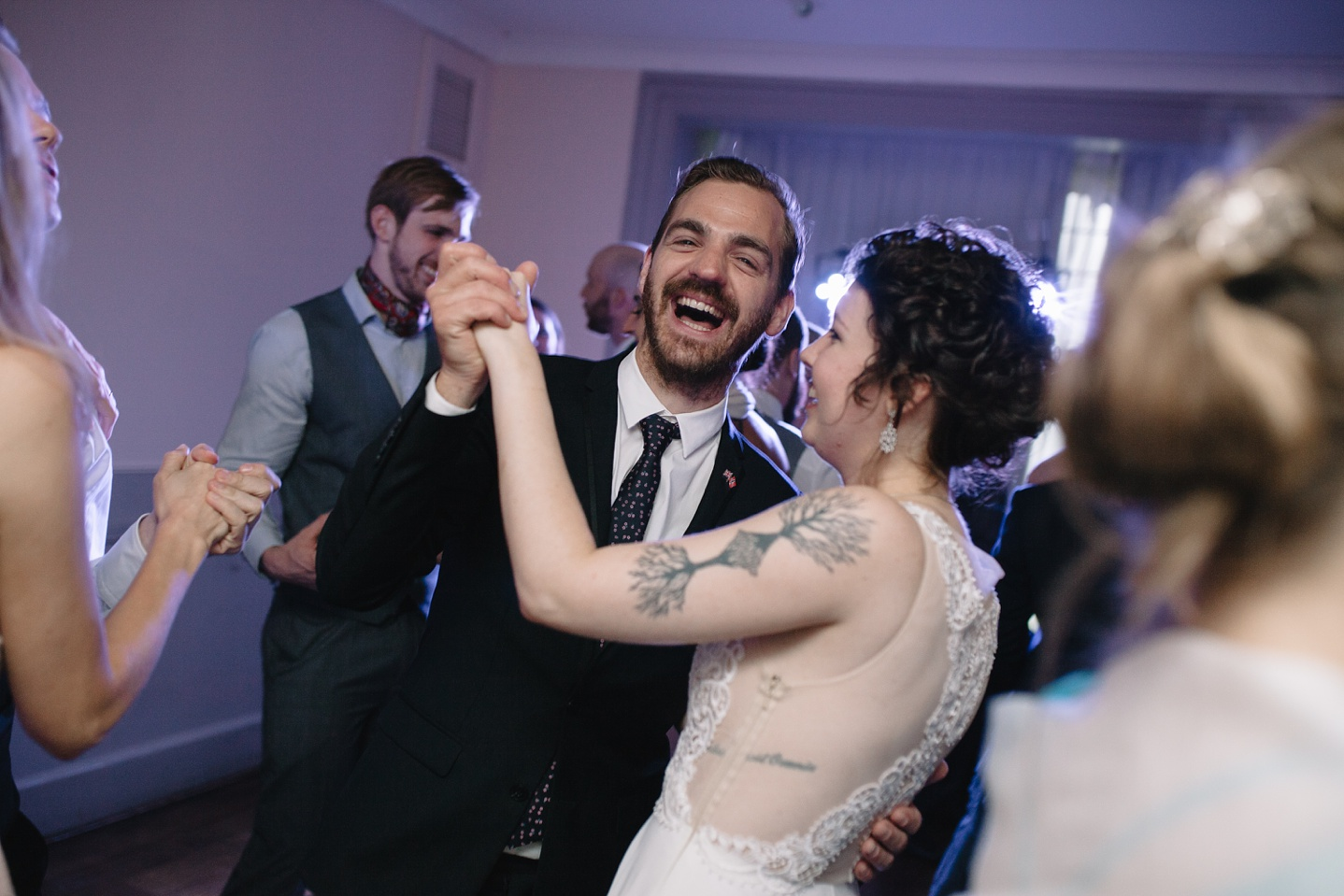 bride and guest dancing and laughing on the dance floor at Whirlowbrook Hall