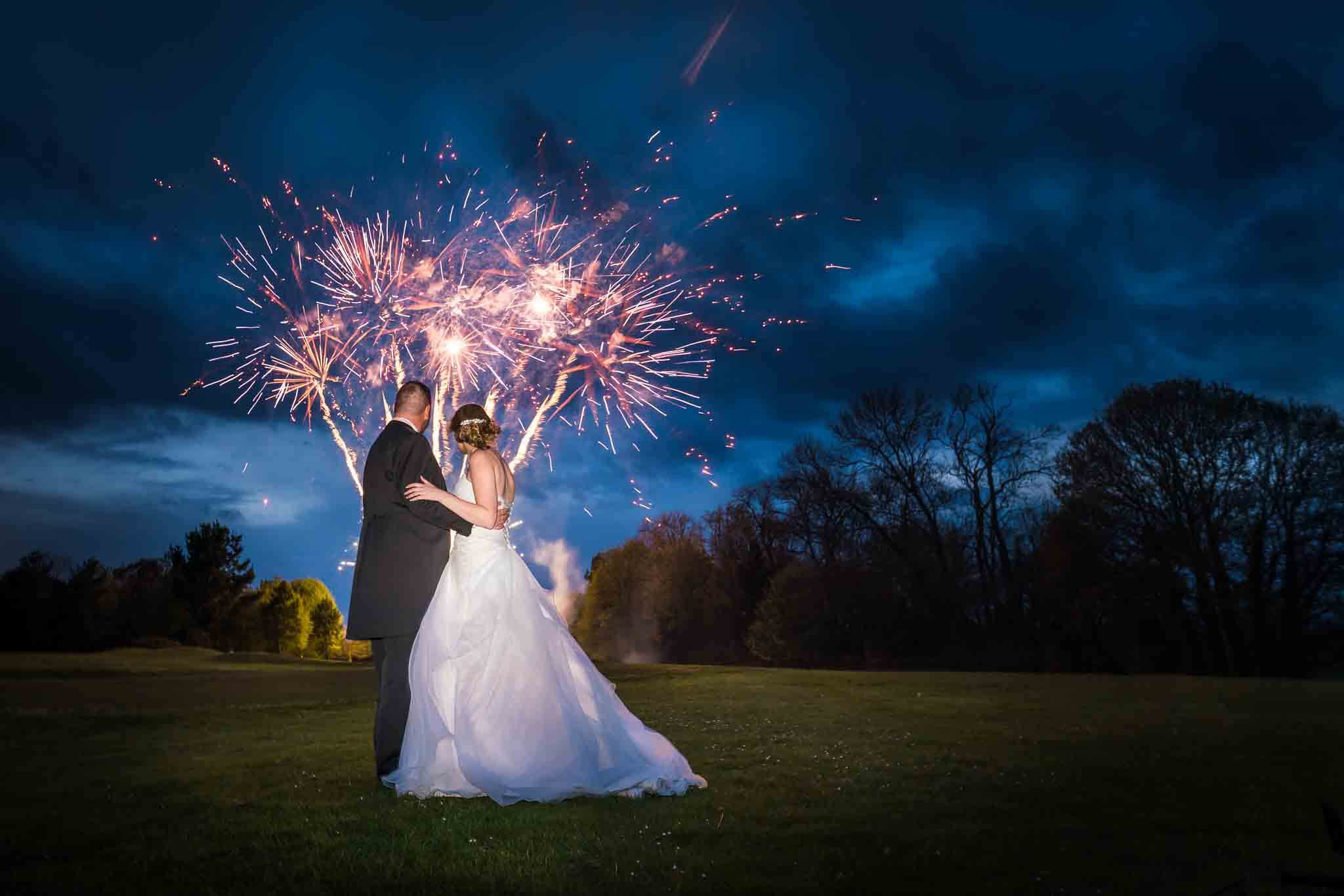 Wiltshire Wedding Photographer, Bride and Groom with fireworks