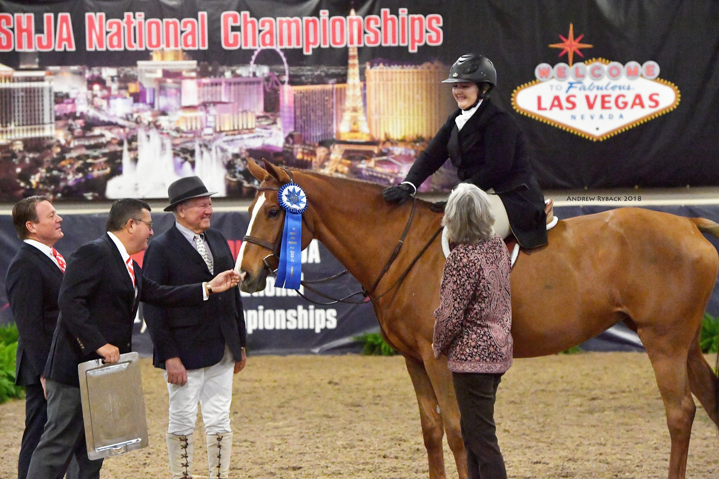 Joe Norick (second from left), Director at Aon Private Risk Management, congratulates winners at the 2018 Aon/USHJA National Championships. Photo © Andrew Ryback Photography.