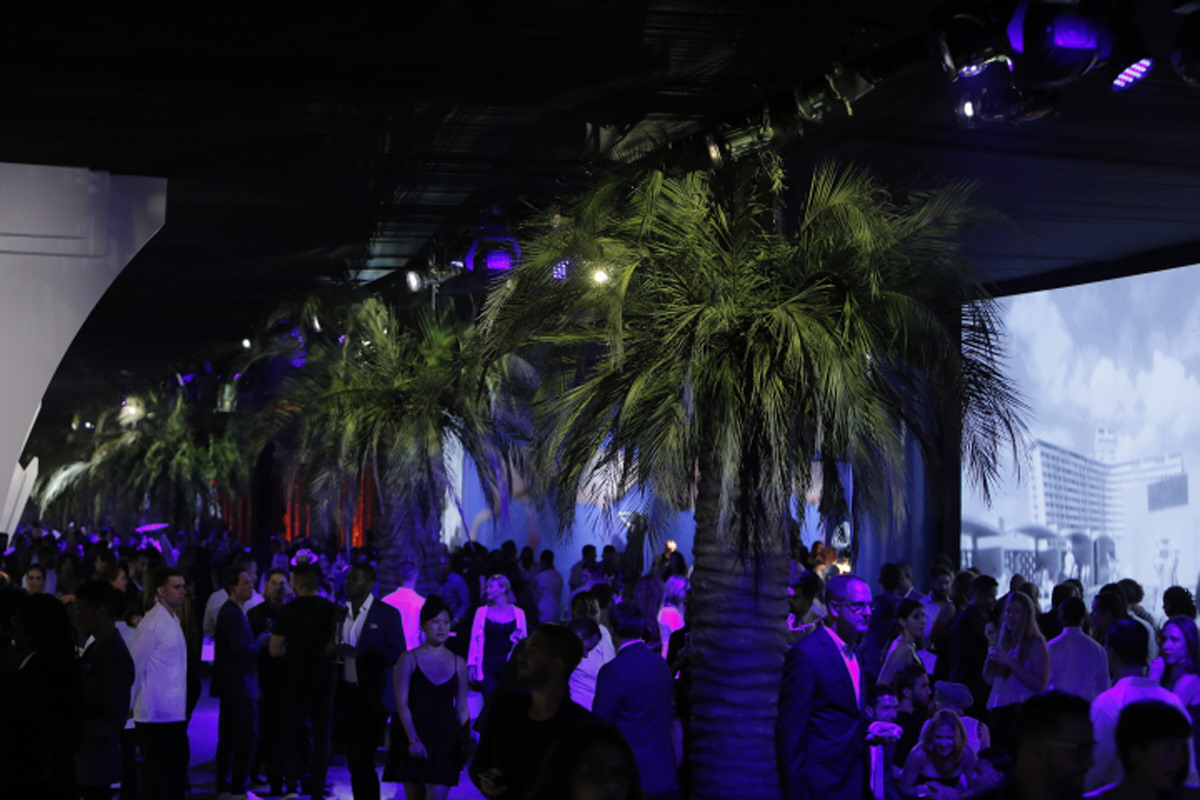 A view of the boardwalk at The Flamingo Party, a 33,000 square-foot immersive party by Hermès.