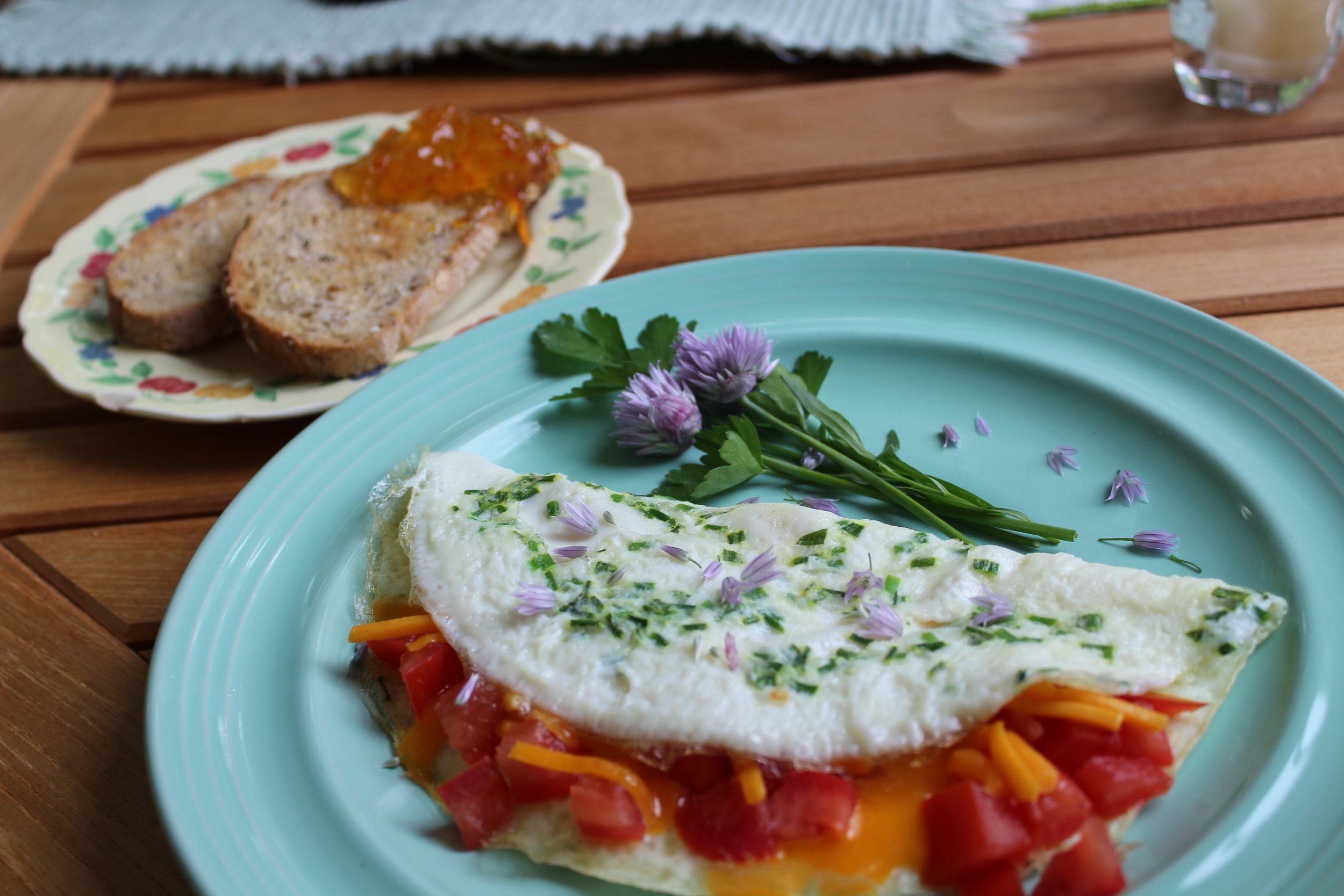 Chive and egg white omelet with tomatoes and cheddar