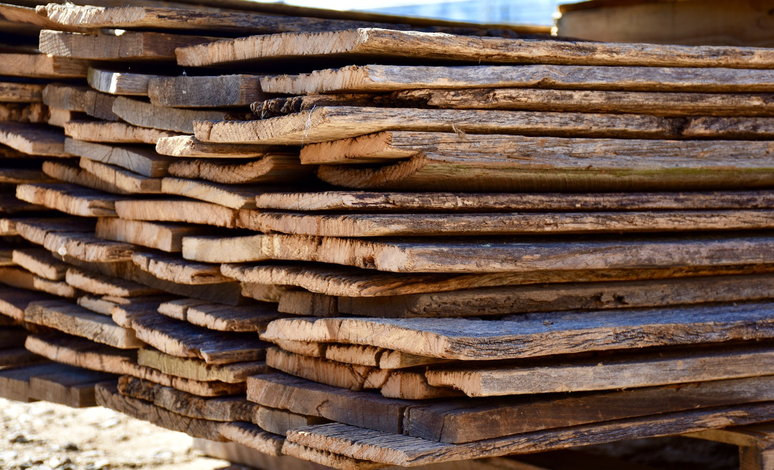 Stacks and stacks of authentic used brown barn siding
