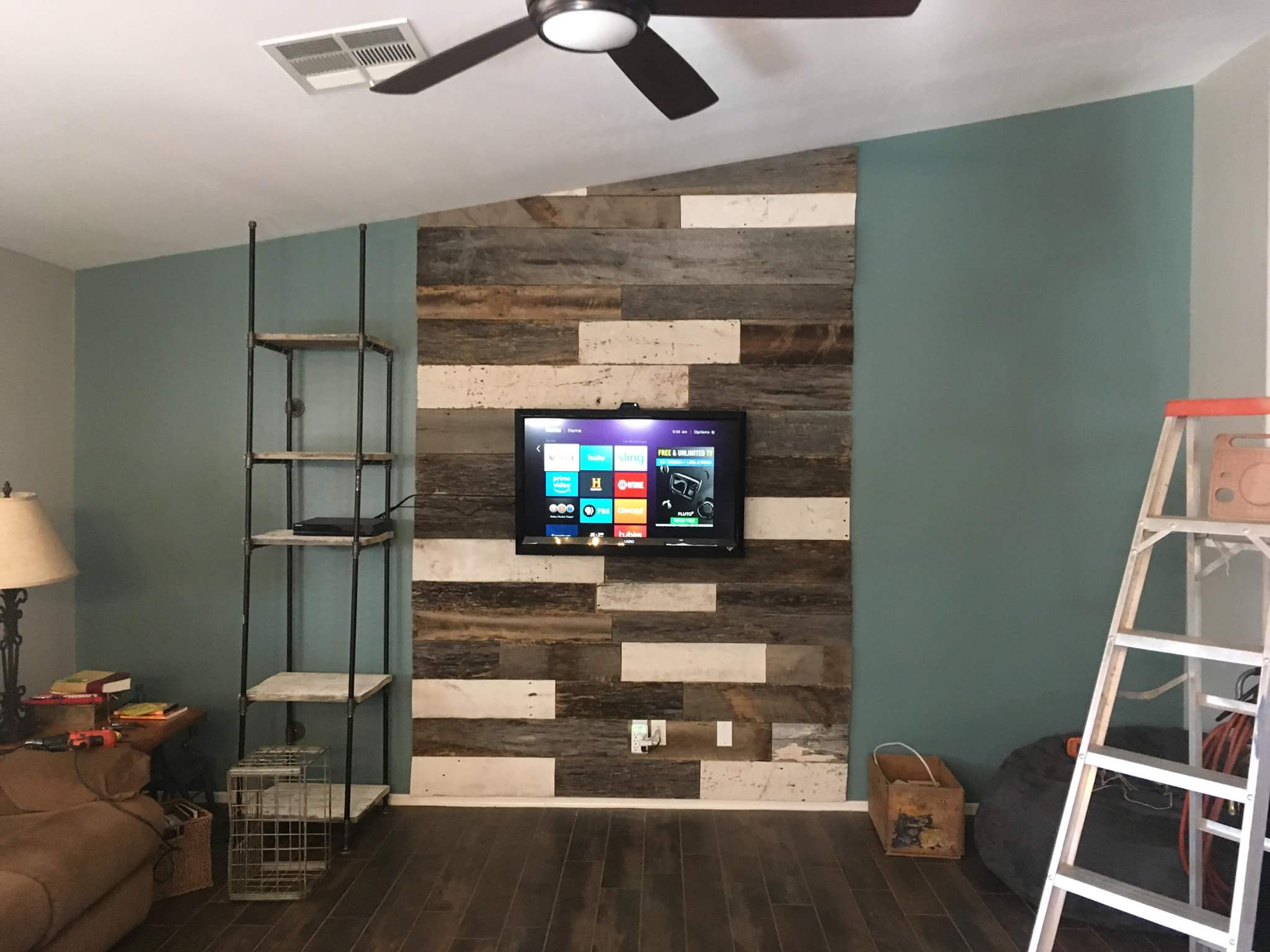 Used barn wood wall cover to spice up the living room