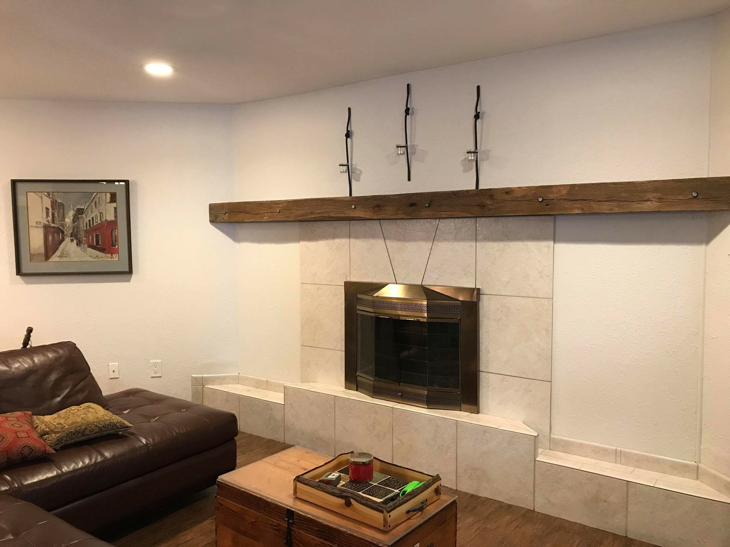 Reclaimed and restored barn beam accent mantle