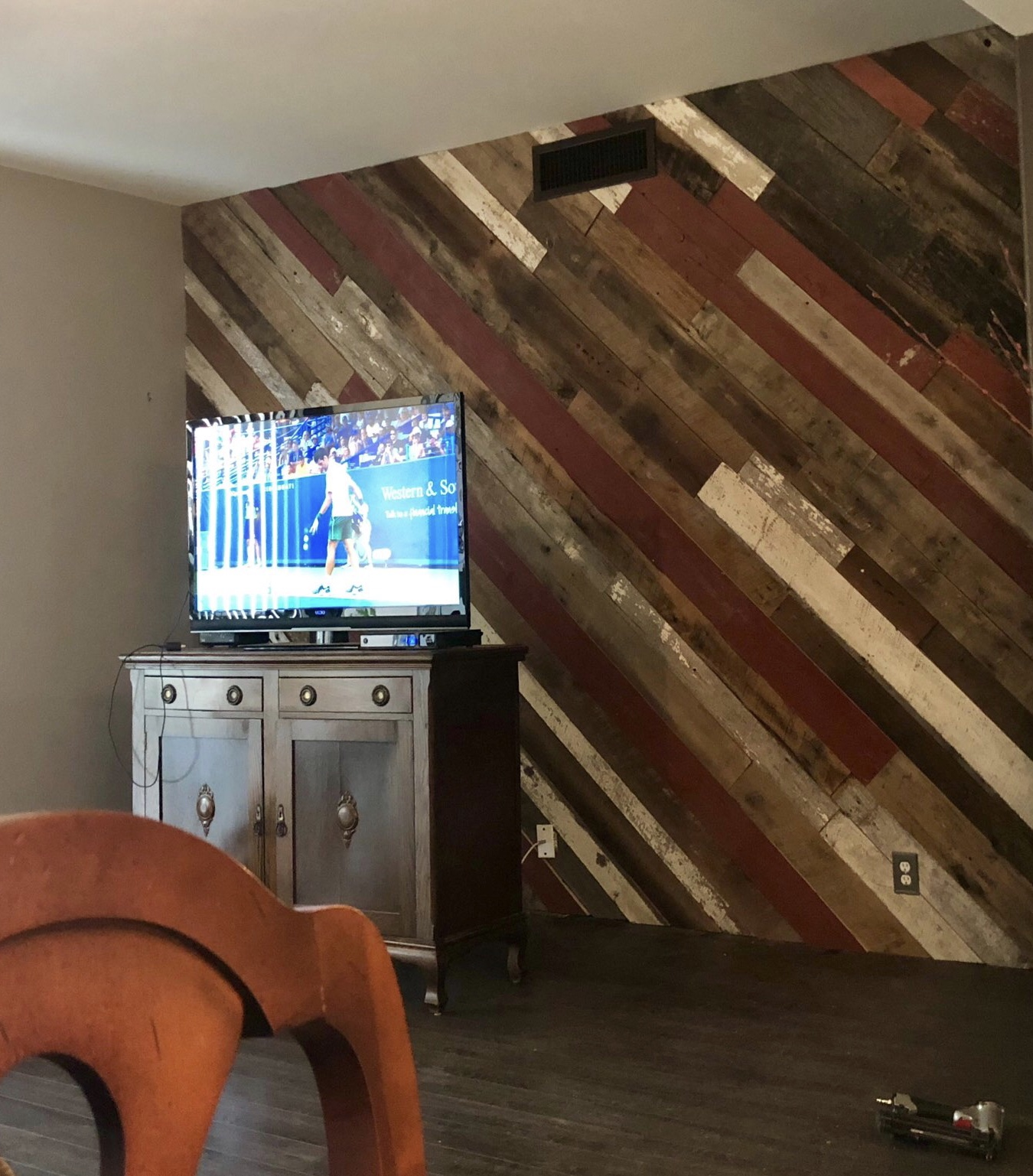 Reclaimed siding diagonal accent wall in rich browns and reds.jpg