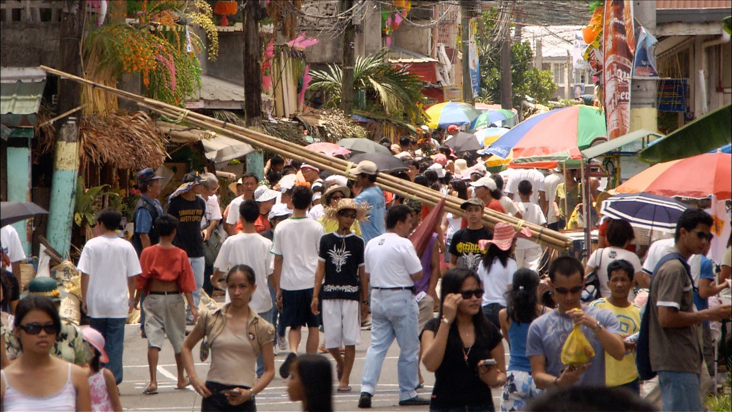 205_Philippines_carrying bamboo poles.jpg