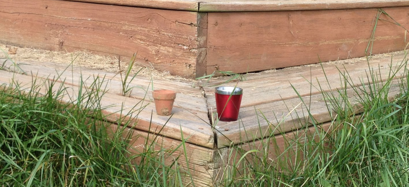 Here is the shot cup and the pot next to each other on the corner of the deck where I leave it.