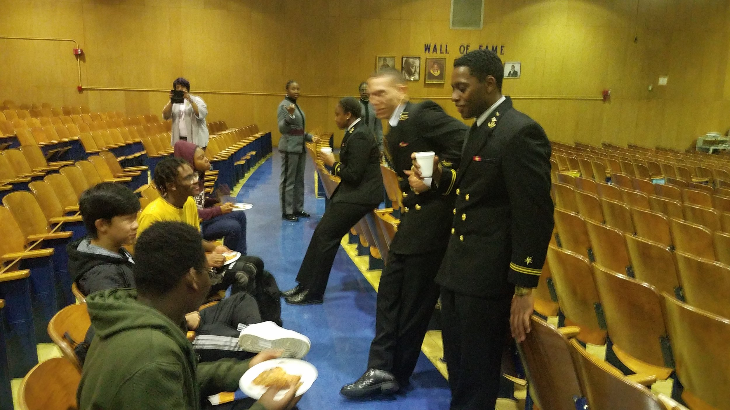 Midshipman spreading knowledge of the USNA with Middle Schoolers.