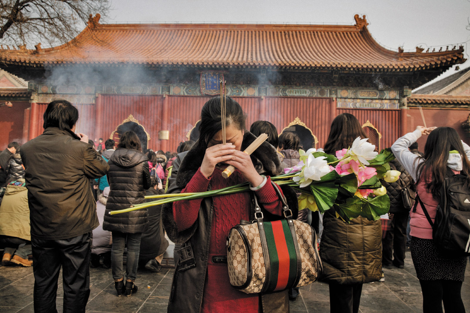 Han Chinese devotees offer incense at the Lama Tibetan Buddhist temple in Beijing on a Sunday morning earlier this year. | Source: Time.com