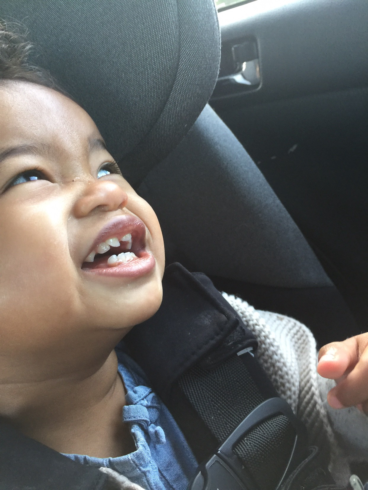 Toothy grins at 17 months