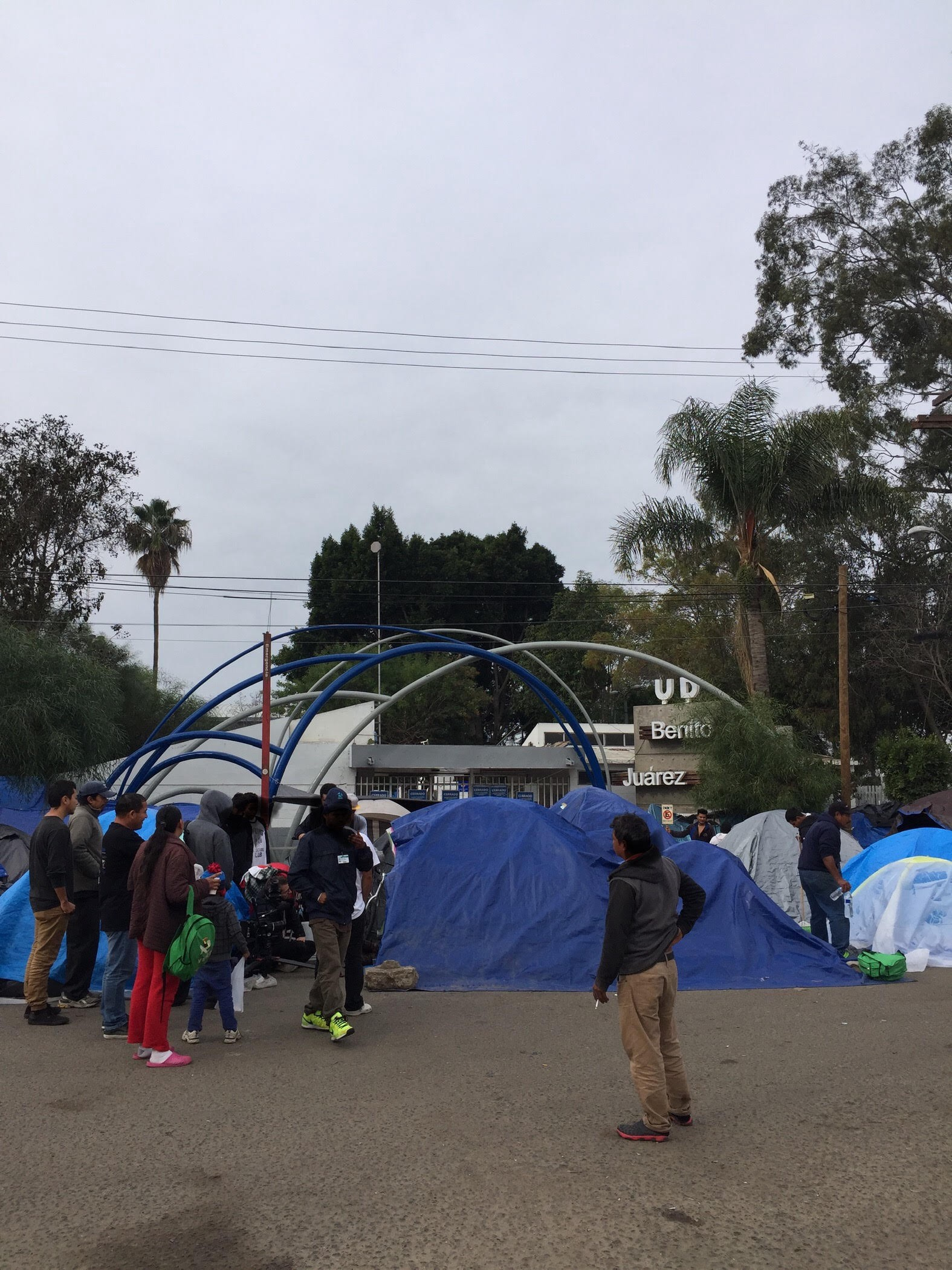 Migrants remaining at the old shelter at Benito Juarez sports complex