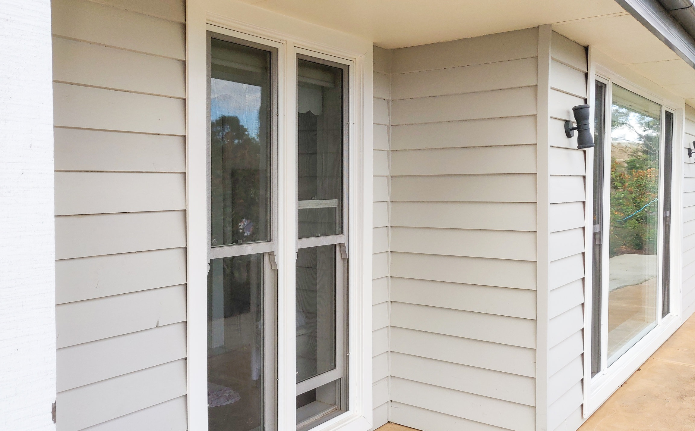 Featuring double hung windows with iconic white trim