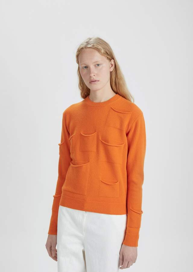 Yes. You are that cool. And if you have a triangle shaped figure, you're going to look even more incredible in this unexpected sweater.  J.W. Anderson Multi Pocket Crewneck Sweater Tangerine. La Garconne. Was: $710. Now: $213.