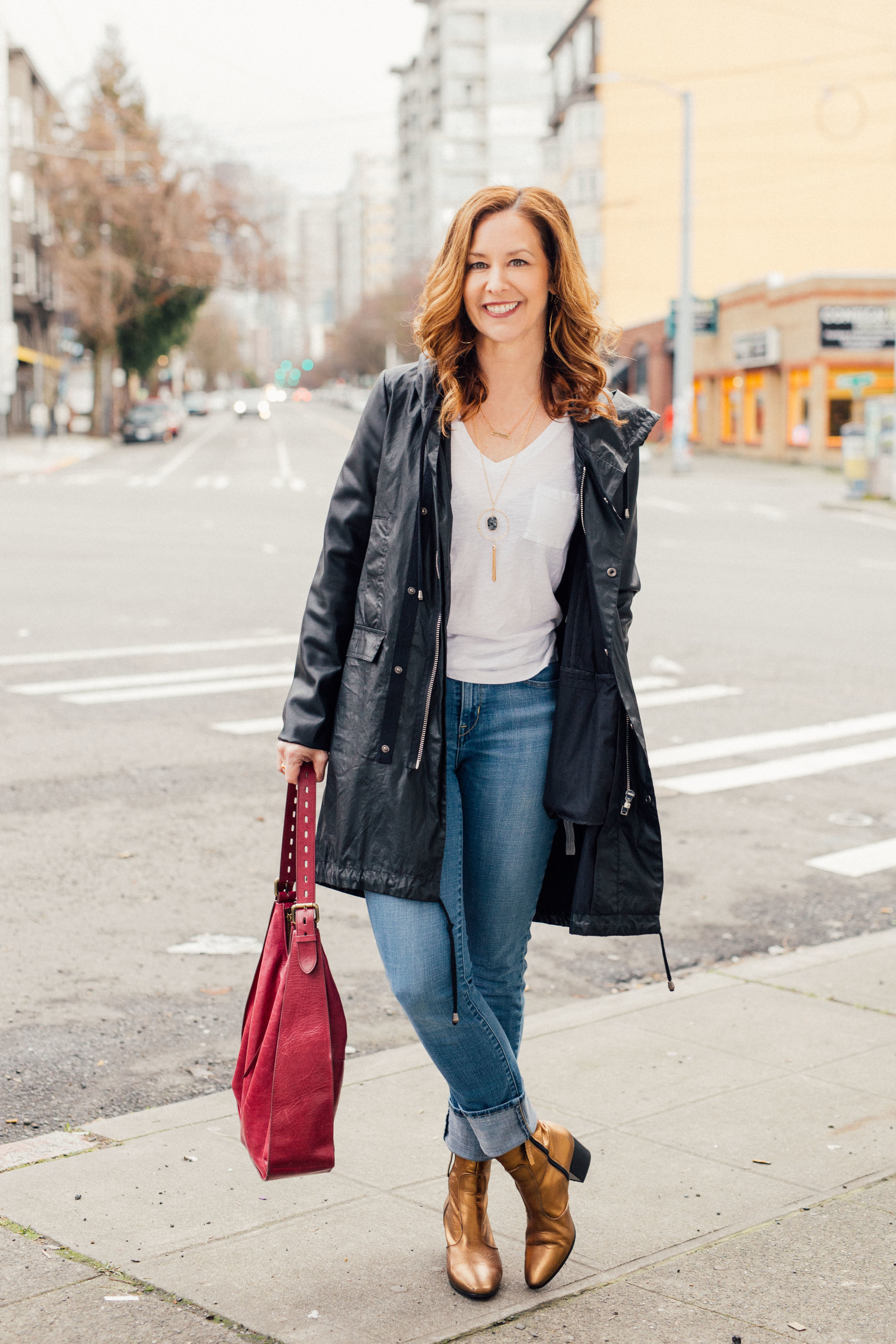 Poplin client Julie is rocking her Top Shop booties in this image from our photo shoot last year. See more about Julie on the Client Stories page. Photo by Amy Paine. Hair and Makeup by  Kat St. John.