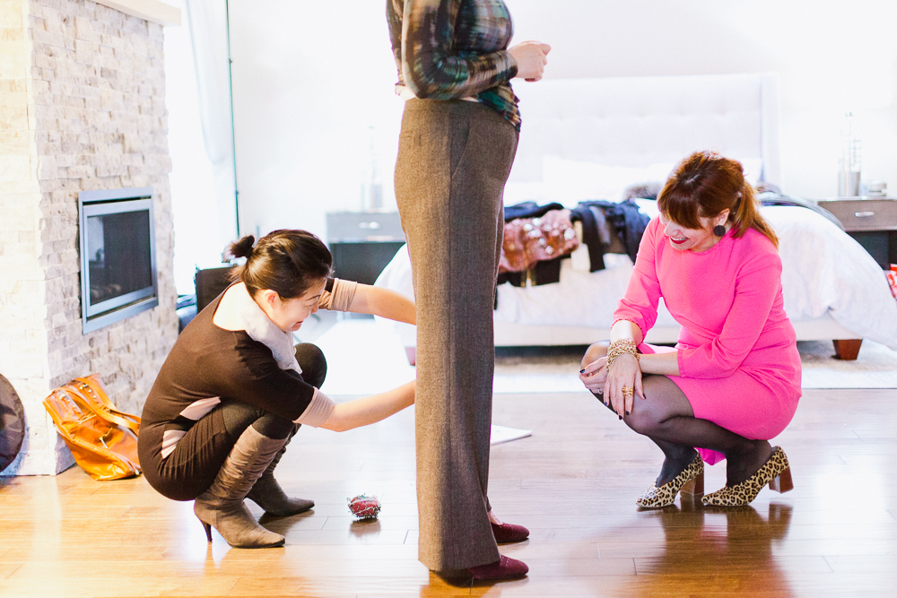 """I love this photo of me and my favorite tailor, Laura, making my client's pants more modern.As an aside, If you've got outdated """"work pants,"""" check out this blog post on how to make them more current. I digress. I also happen to be wearing shoes from Zara. Photo by Kat St. John."""