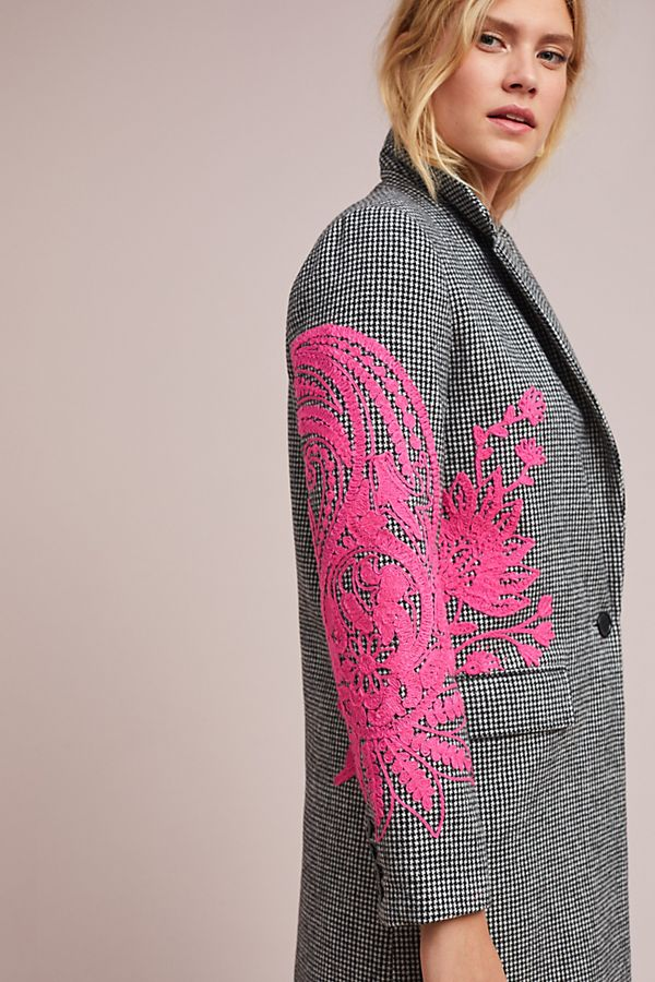 With one of a kind embroidery.