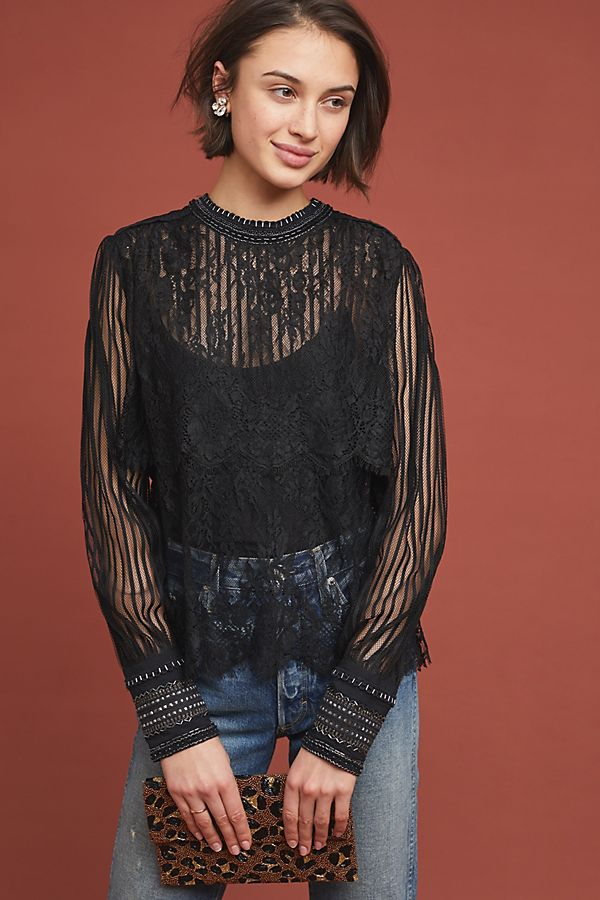 And a sheer lace top. More is more.