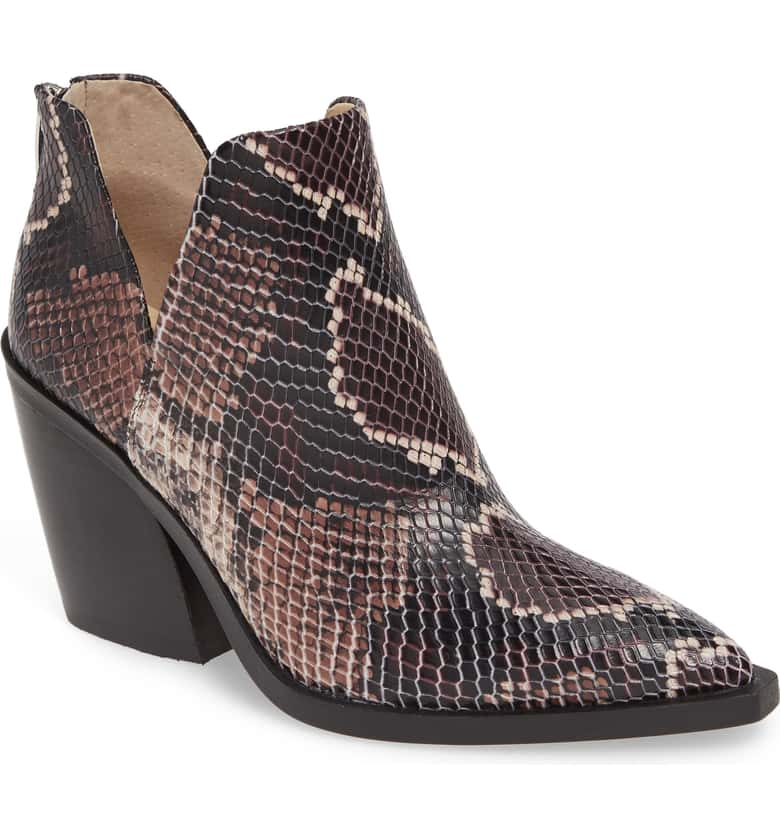 Clearly animal prints and textures are all the rage this fall. The slit on the side elongates your leg and this heel is functional for the office or the weekend.
