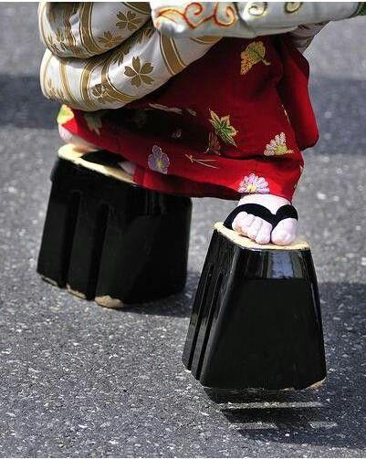 A Japanese Geisha wearing Okobo Sandals