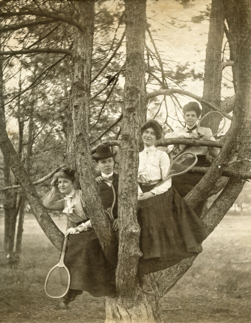 Victorian's in a tree with tennis rackets