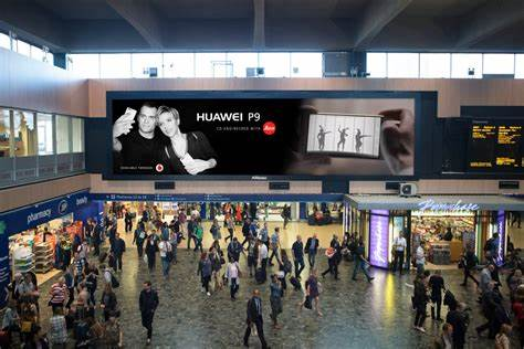 A huge digital billboard carefully placed just to the side of the departures board at Euston station.  Image :  JCDecauxUK
