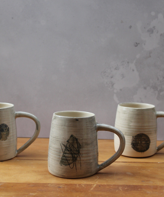 Kate Welton, Mugs, thrown stoneware with slip decoration.jpg