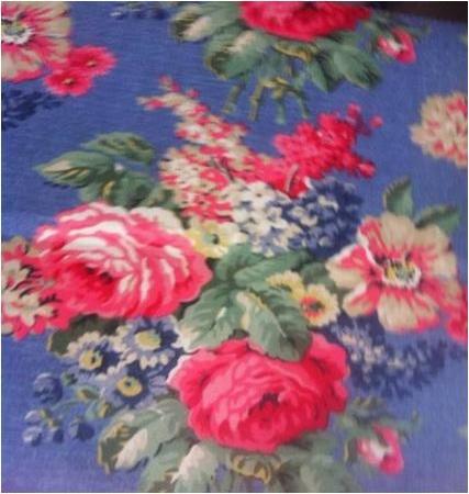 Tela flores fondo azul hule