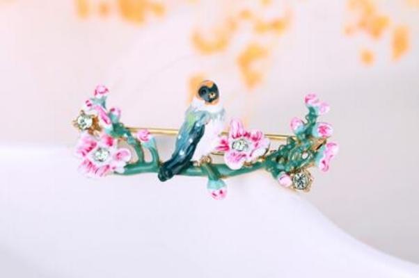 prendedor les fleurs pájaro