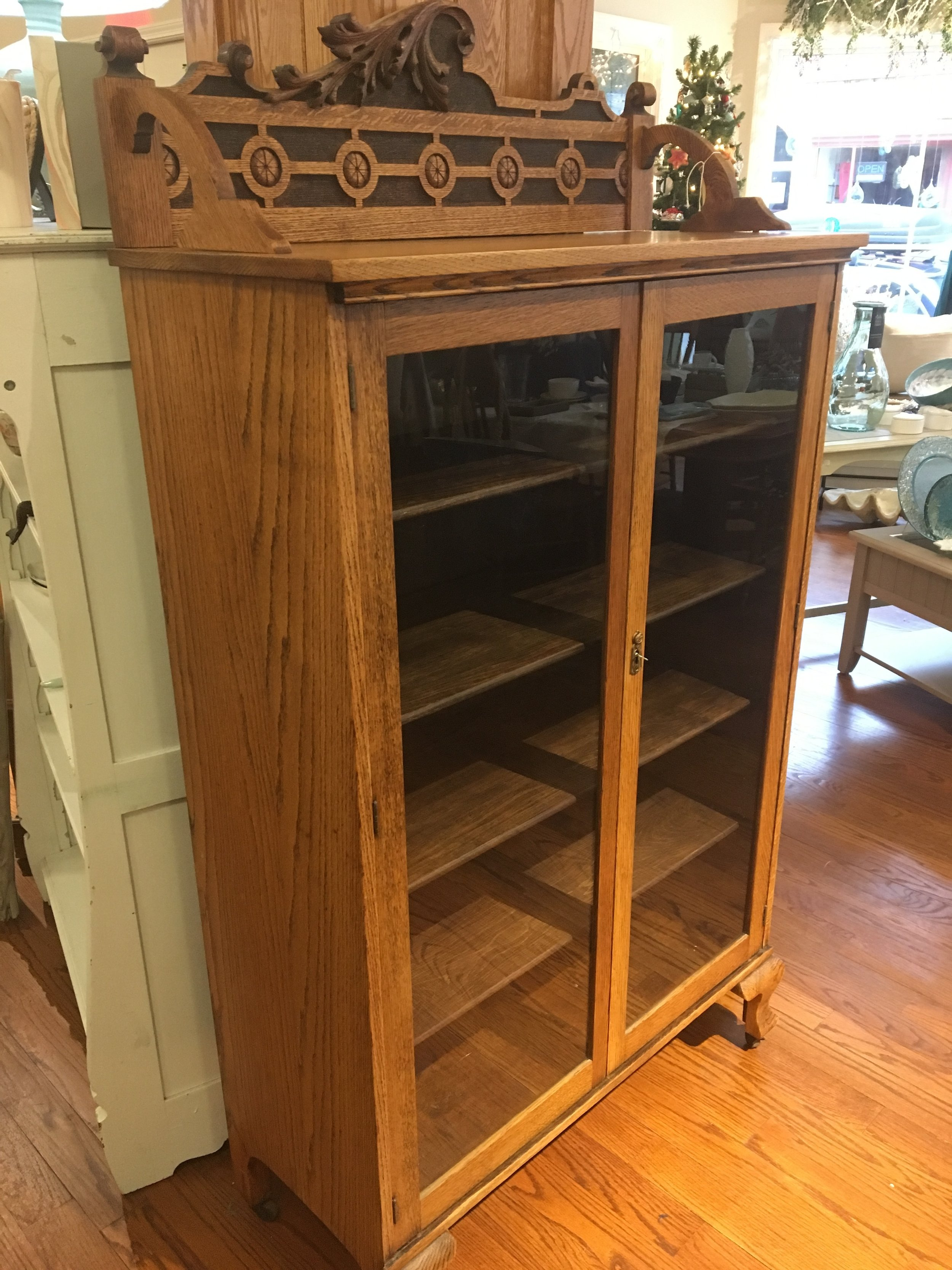 Gorgeous antique oak bookcase with hand carved crown.JPG
