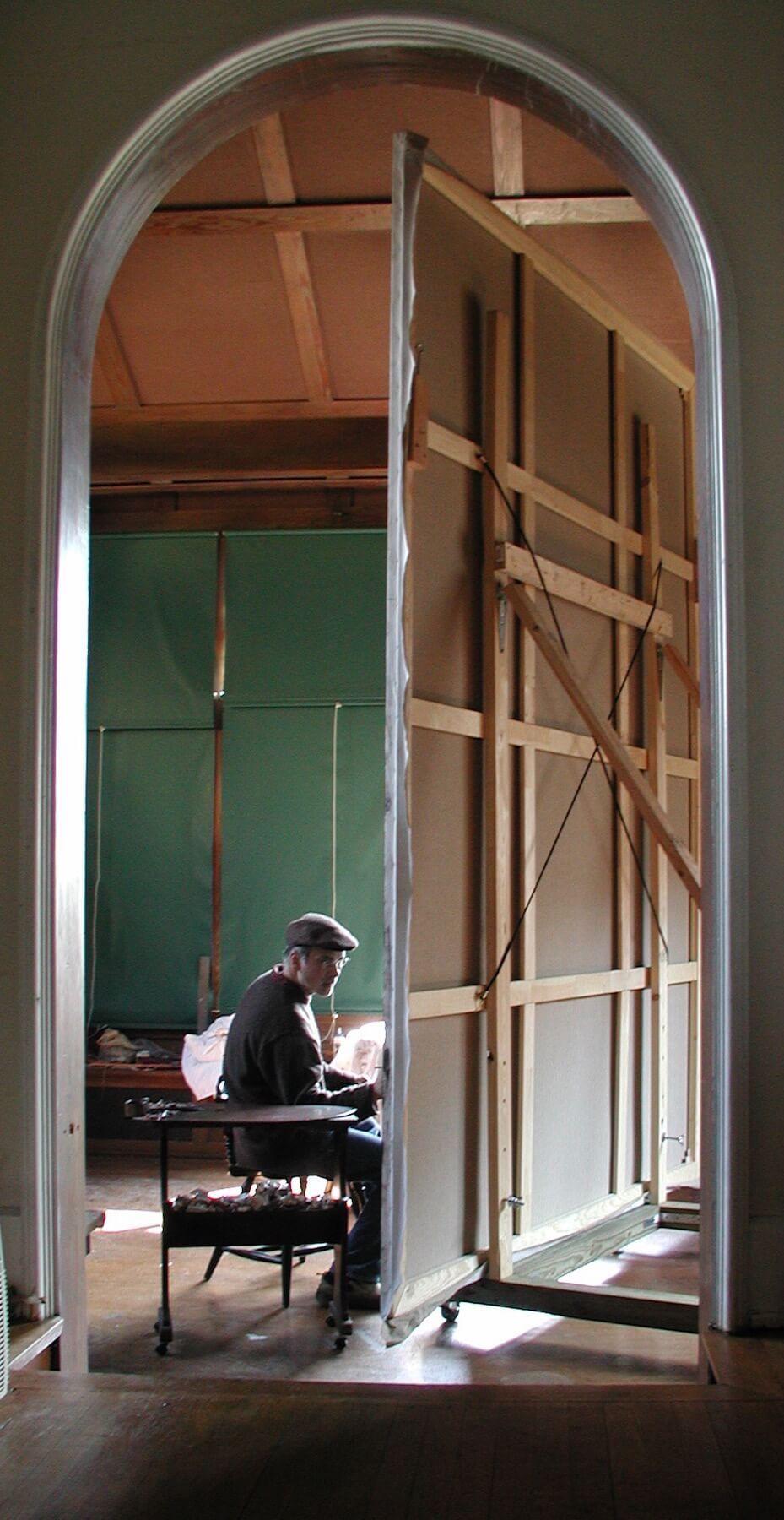 Carl Samson with large multifigural painting in art studio