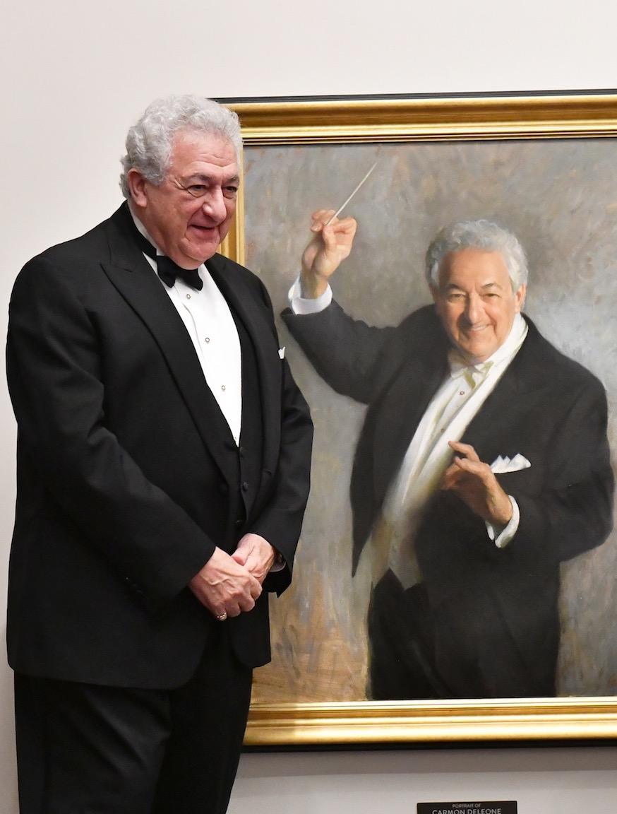 """Maestro Carmon DeLeone with  Portrait of Carmon DeLeone , 40"""" x 30"""", oil on linen canvas, Music Hall collection. Photo by Steven Thomas."""