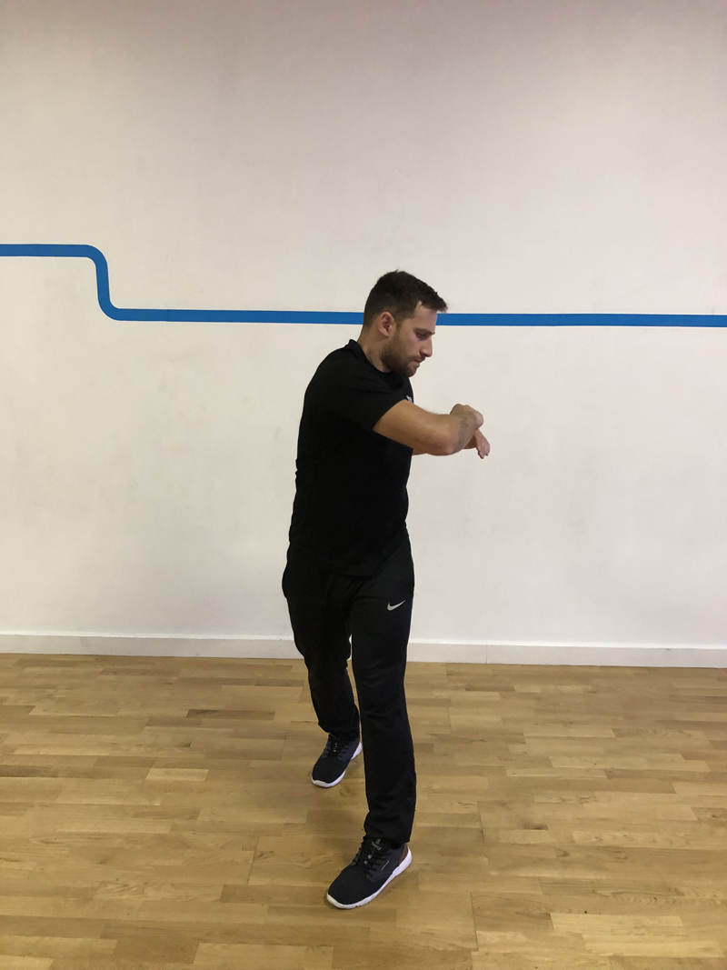 7. - Stand upright with your feet about shoulder-width apart and your arms at 90° in front of your chest. Twist your upper body from left to right looking in the direction that you're turning. Make sure you're twisting at the upper body, not at the hips. Do 10 repetitions each side