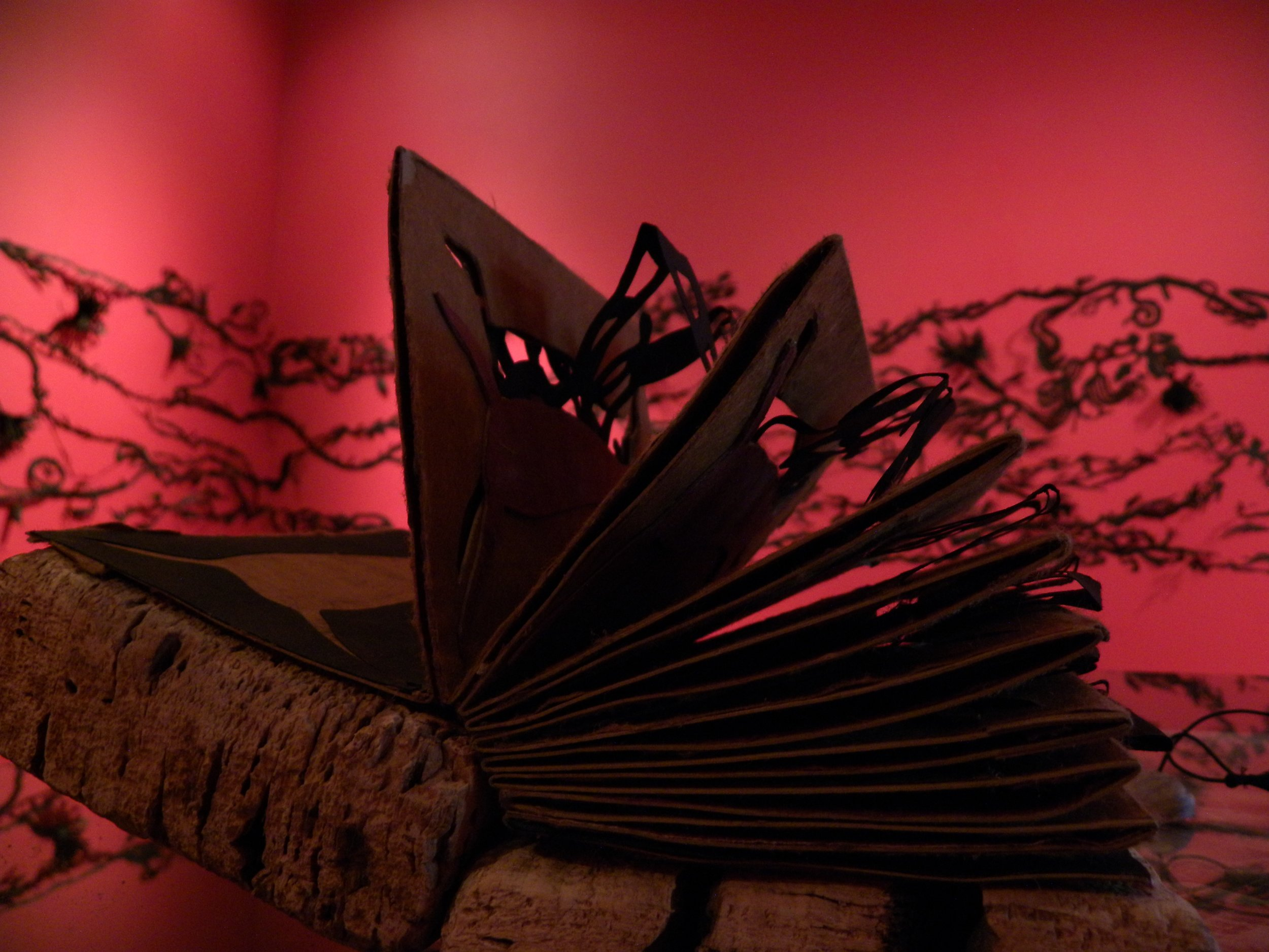 """""""Book of Skates"""", cut paper tunnel book with cork cover, 7""""H x 5""""W x 4""""D, (closed), 2009"""