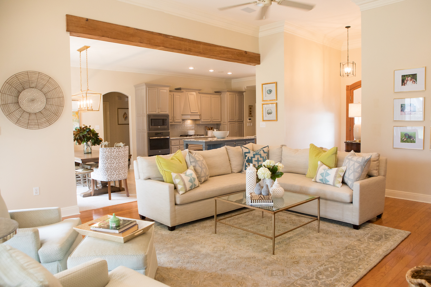 Open concept floor plan with natural light and blue accents