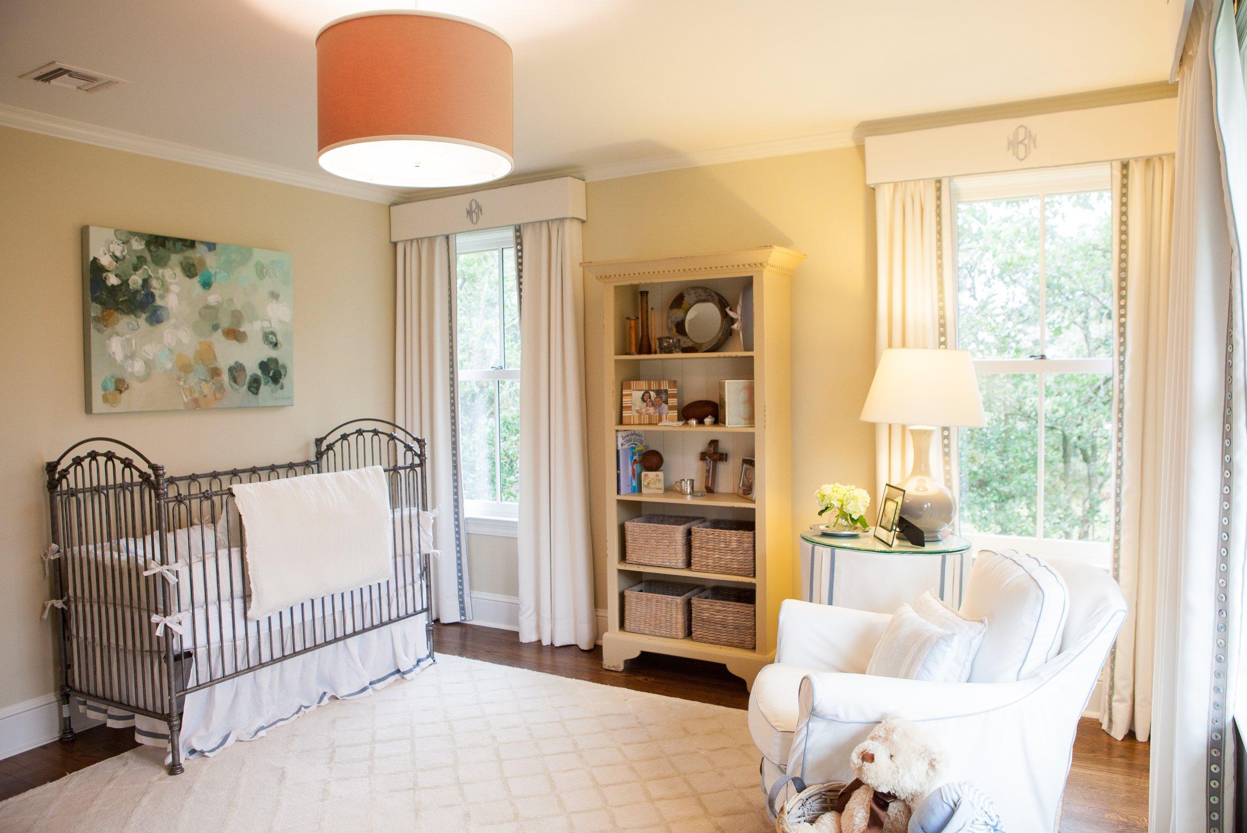 nursery design with iron crib and custom curtains