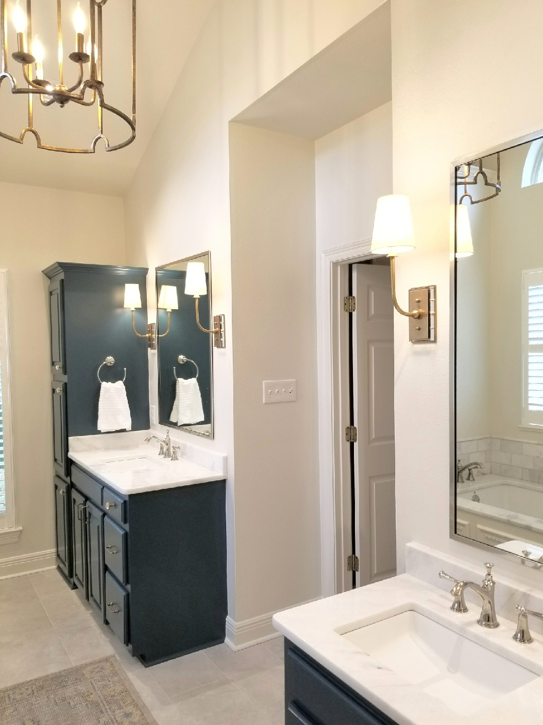 bathroom remodel with white countertops and deep blue cabinets