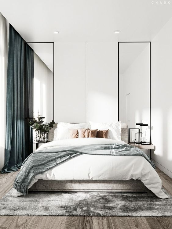 Having two mirrors besides the bed gives a larger feeling to the room