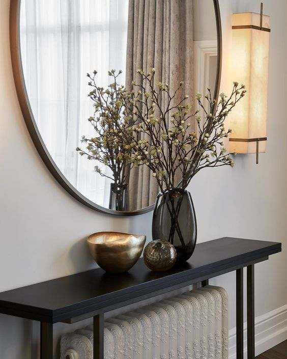 Keep the entrance simple with a narrow console table and a mirror