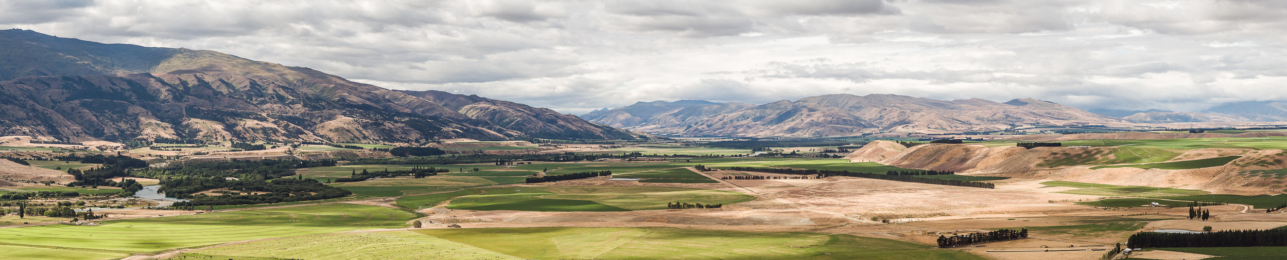 Remnants of the Pleistocene Epoch surround Zebra's Bendigo Flat Vineyard (centre frame), taking in the Pisa Range to the west,Great Rock and Grandview Mountain's peaks landmark the north towards Hawea Flat, while to the east Tarras guards the gateway to the Lindis Valley and beyond.