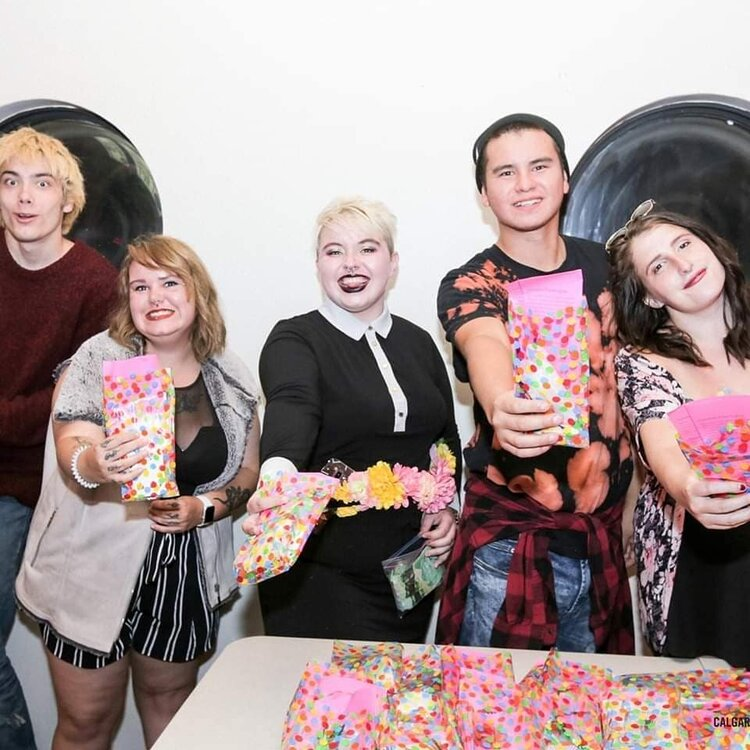 Pride Screening of Rocky Horror Picture Show; a group of Katimavik volunteers showing off the survival kits