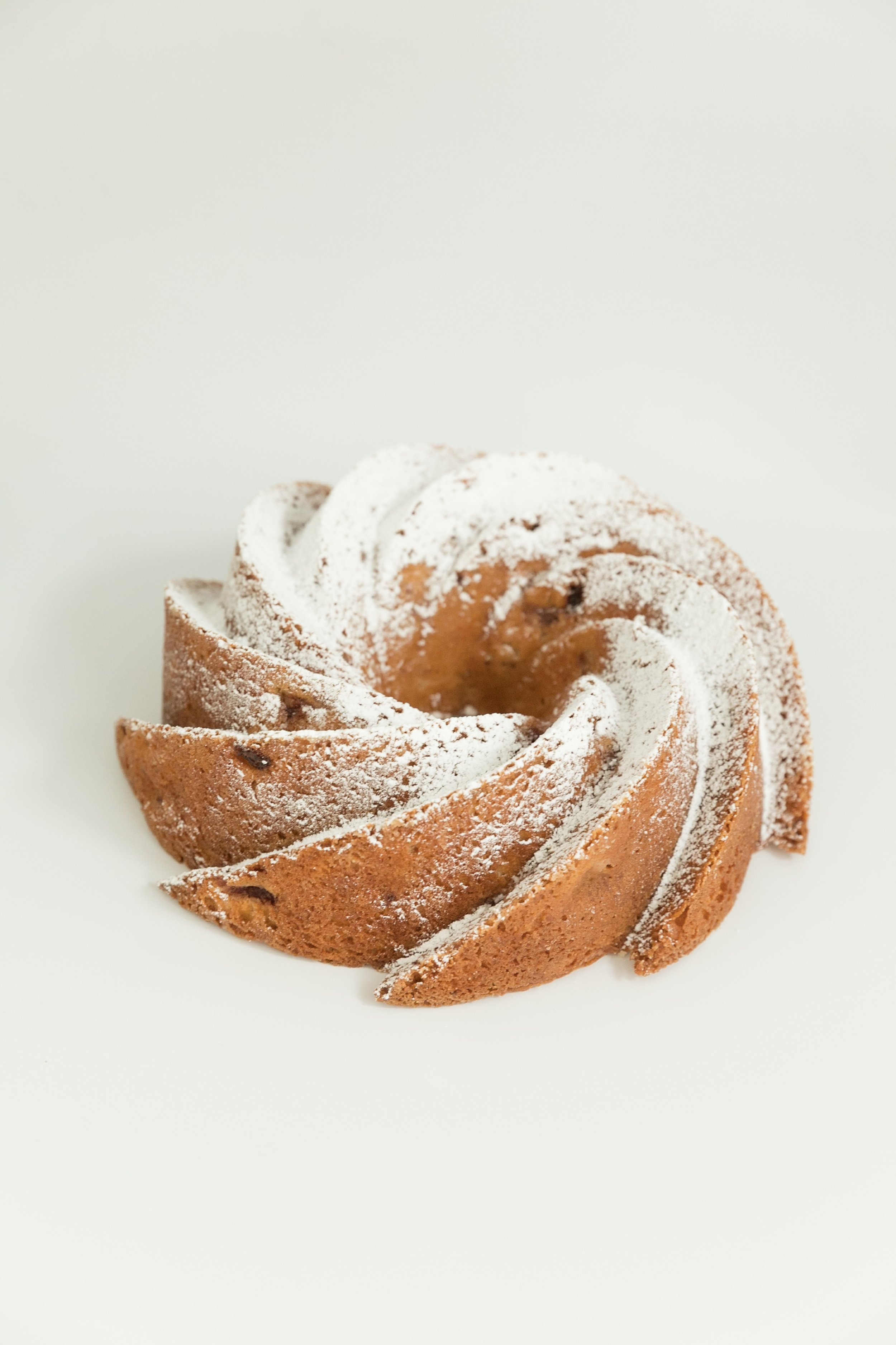 strawberry bundt cake topped with a light dusting of powdered sugar