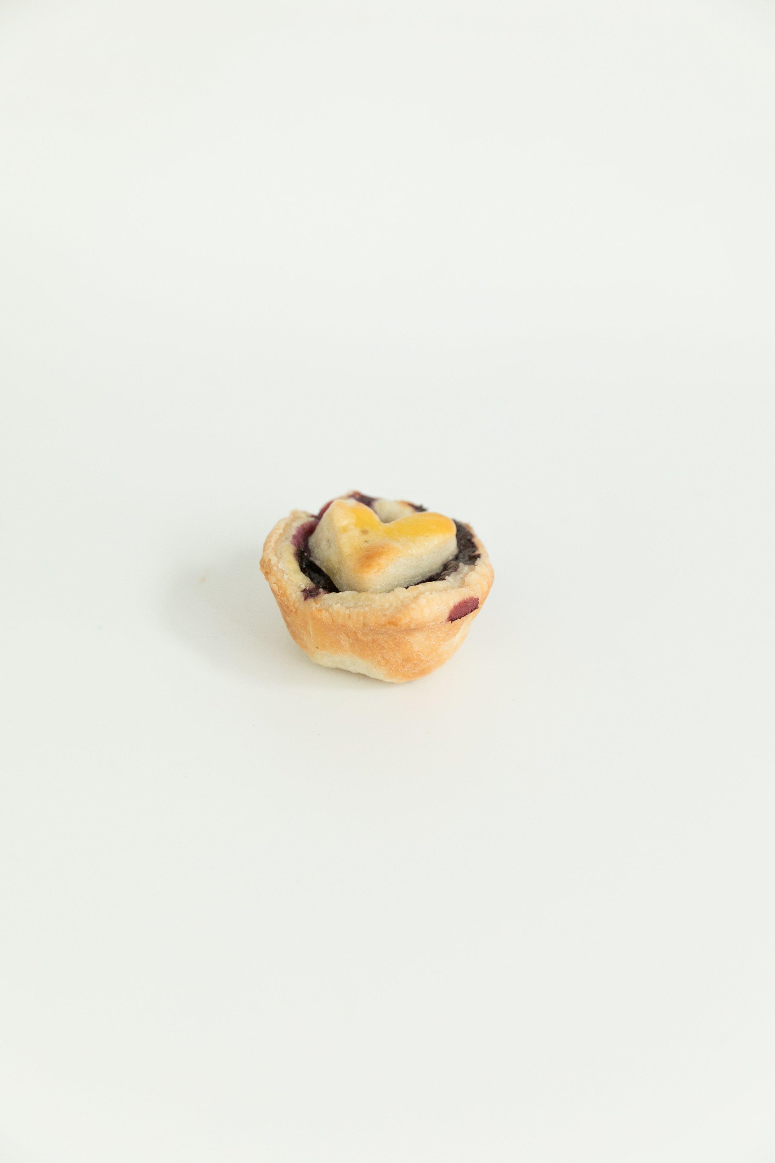 mini mini blueberry pie with heart top