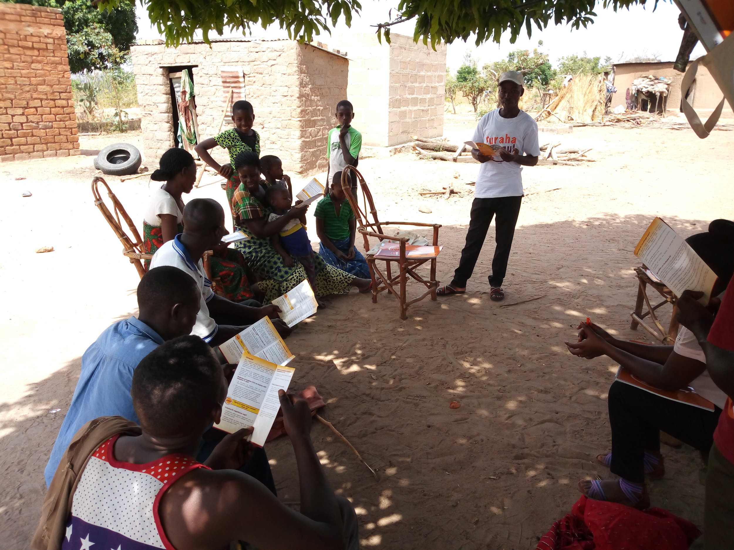 Community Health Worker (Julius John) conducting Interpersonal communication (IPC) sessions during Household visit.