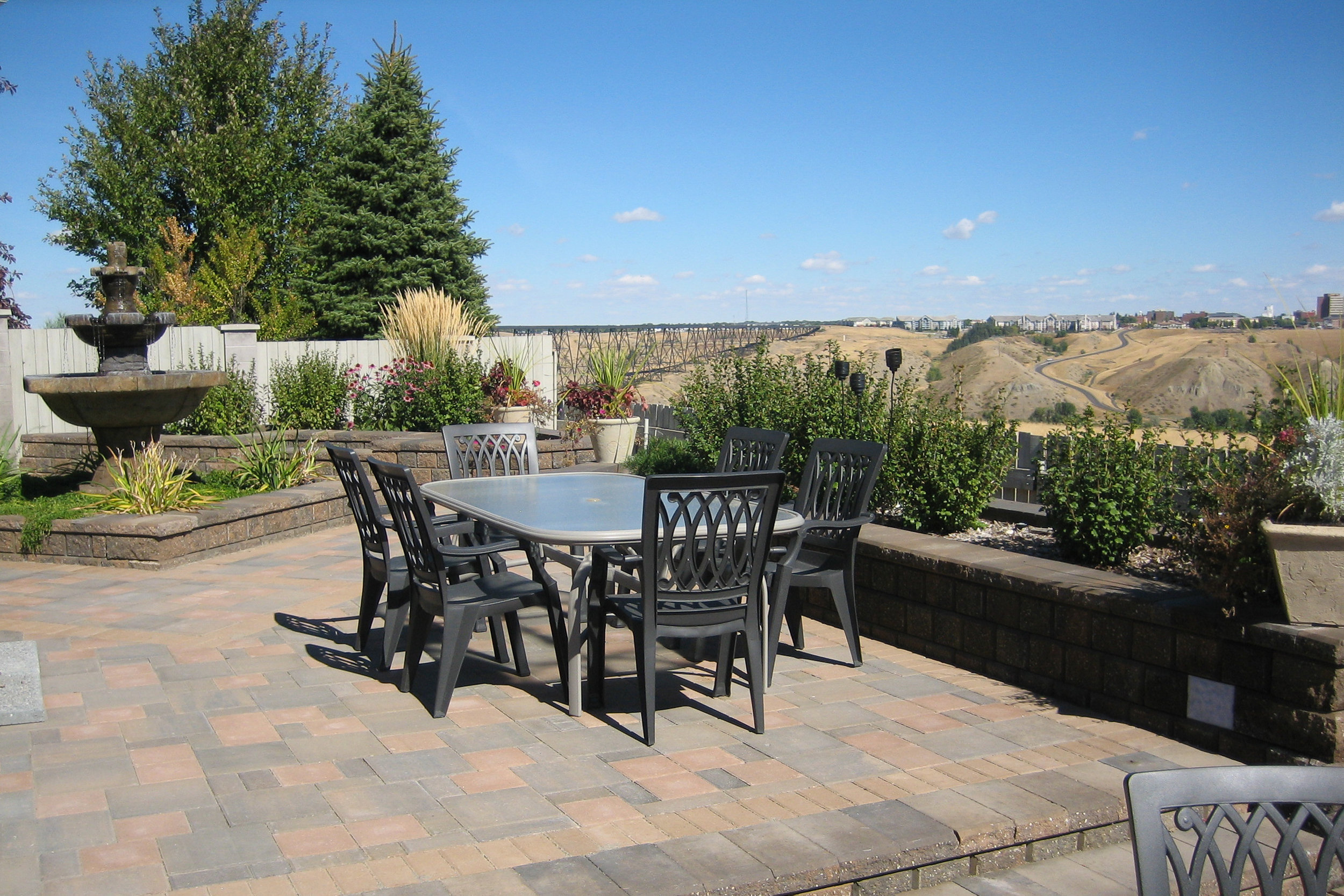 A paving stone patio can create your own personal oasis.